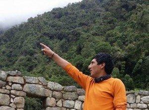 man pointing toward the sky