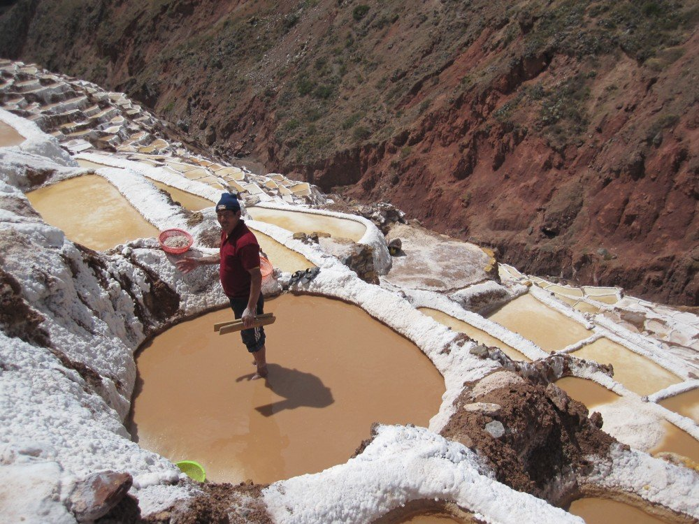 Salineras (salt mines) worker, Sacred Valley, Cusco, Peru