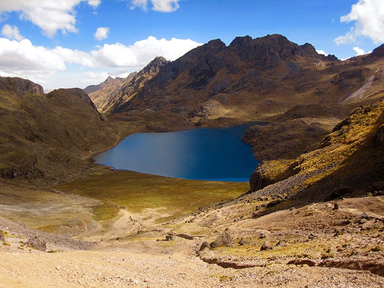 aurora cocha lake on the lares valley trek in peru killa expediitons