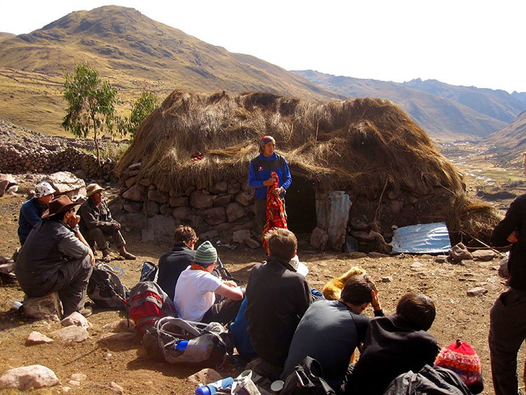 cultural treks local traditional people in their stone houses on the lares valley trek in cusco peru killa expeditions adventure trekking trips
