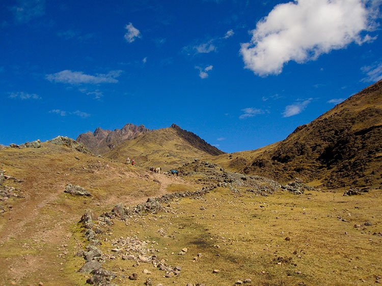 summiting a pass on the lares valley trek in cusco peru