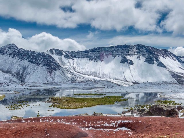 rainbow mountains covered with snow
