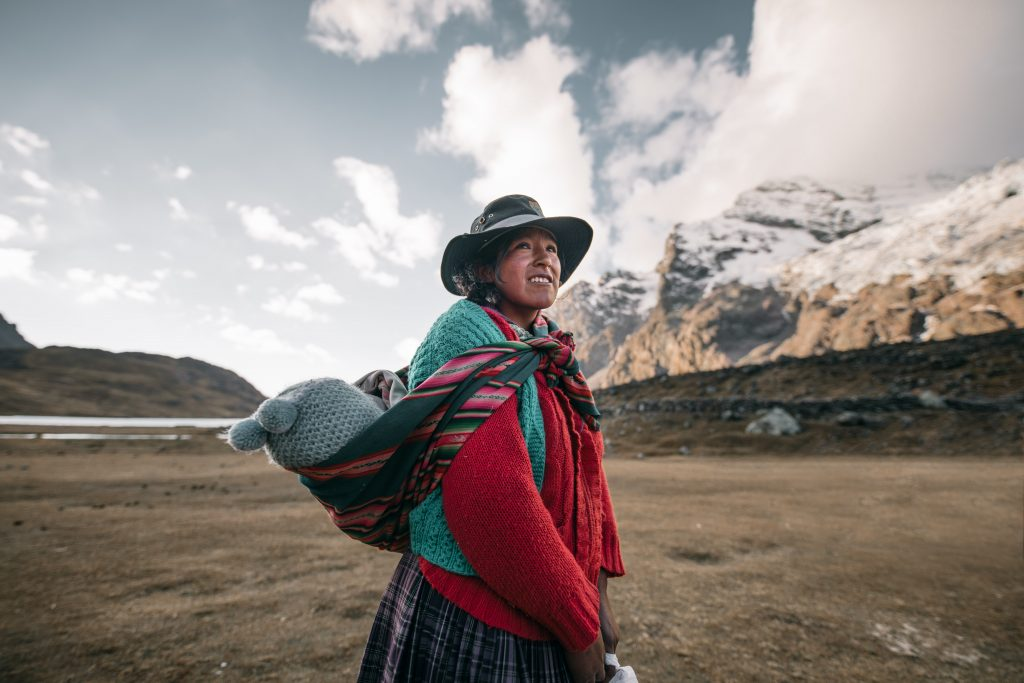 Ethical Travel in Peru - woman carrying baby